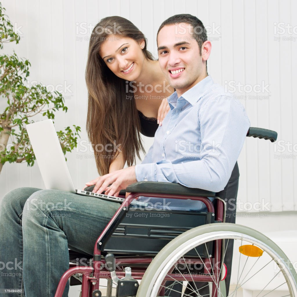 Young disabled man and girlfriend royalty-free stock photo