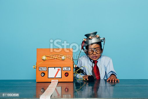 istock Young Dishonest Businessman with Lie Detector 511990898