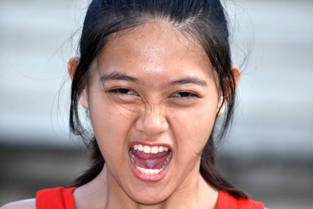 A Young Diverse Female And Anger A person in an outdoor setting antagonize stock pictures, royalty-free photos & images