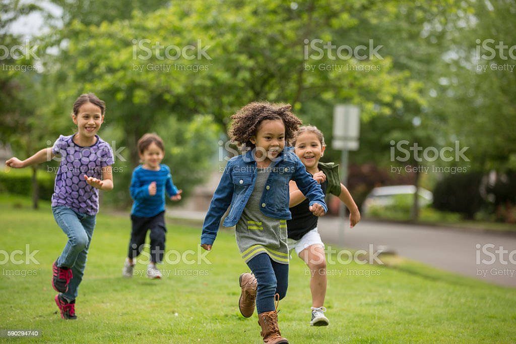 Young diverse girls playing together royaltyfri bildbanksbilder
