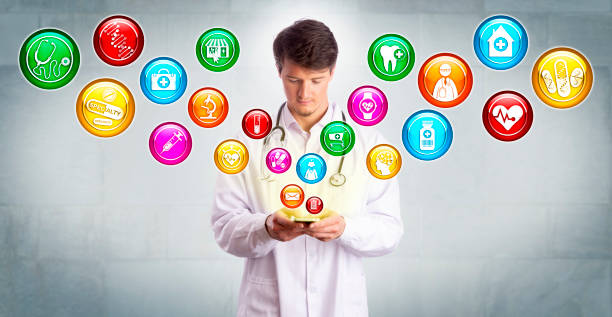 Young Doctor Accessing Medical Apps On Smartphone stock photo