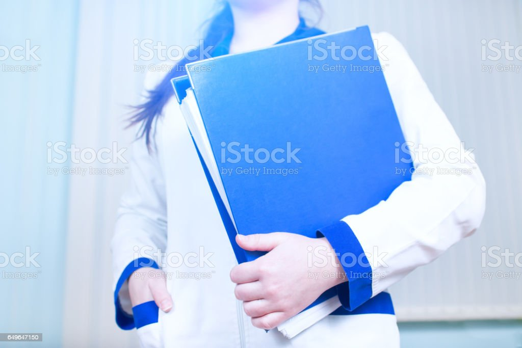 Young doctor girl with a folder of documents stock photo