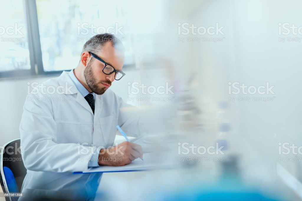 young doctor in uniform working at testing laboratory at clinic, doctor concept stock photo