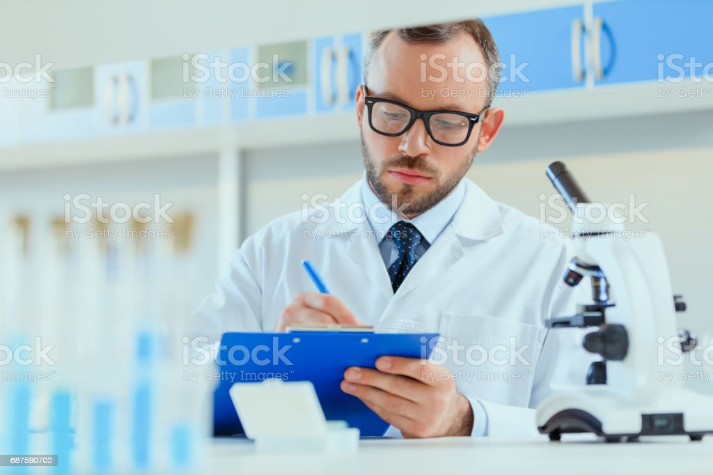 young doctor in uniform working at testing laboratory at clinic, chemical laboratory stock photo