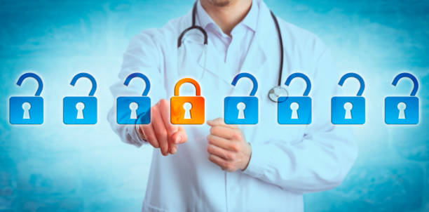 Young Doctor Locking Padlock In Data Stream stock photo
