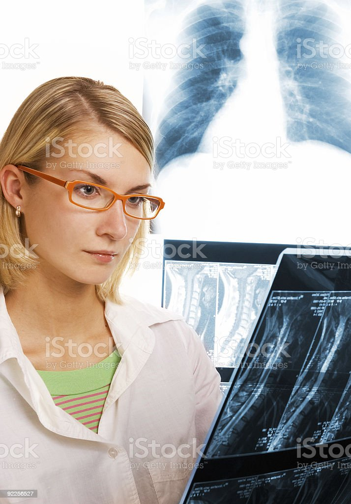 Young doctor looks at roentgenogram royalty-free stock photo