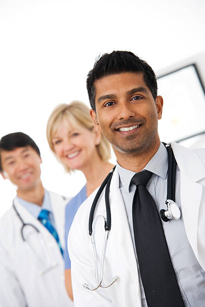 Young Doctor with medical team stock photo