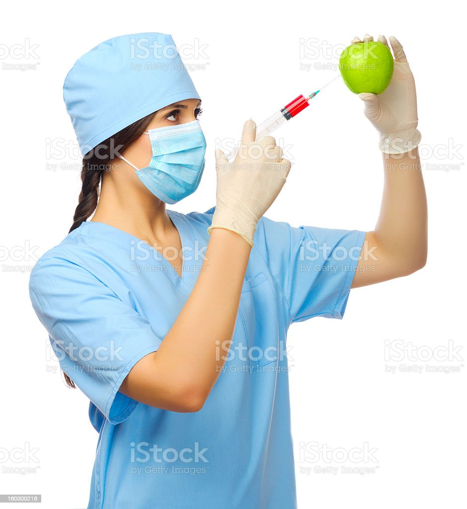 Young doctor with syringe and apple royalty-free stock photo