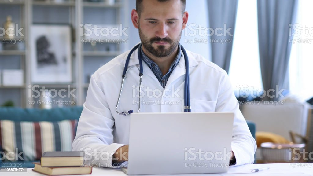 Young Doctor Working On Laptop stock photo