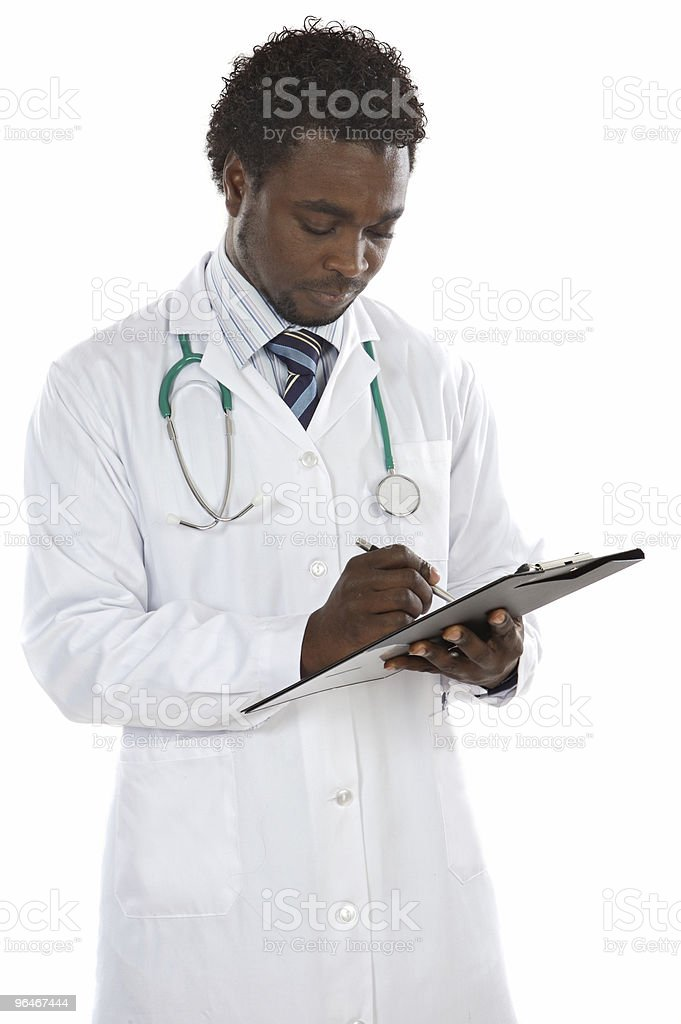 young doctor writing royalty-free stock photo