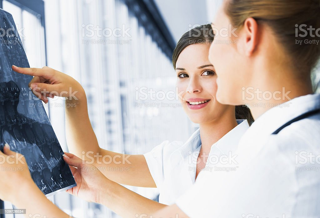 Young doctors checking an MR exposure royalty-free stock photo