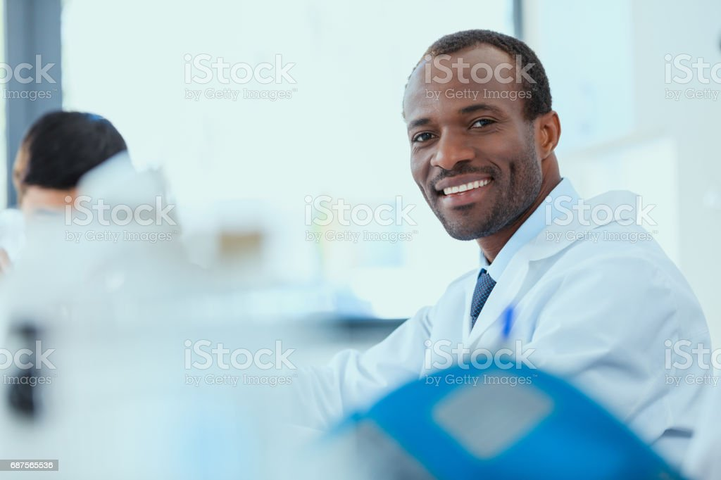 young doctors in uniform working at testing laboratory, chemical laboratory stock photo