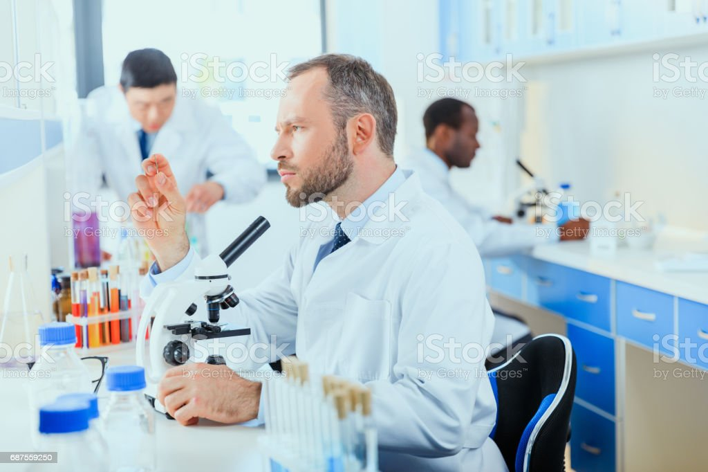young doctors in uniform working at testing laboratory, laboratory technicians stock photo