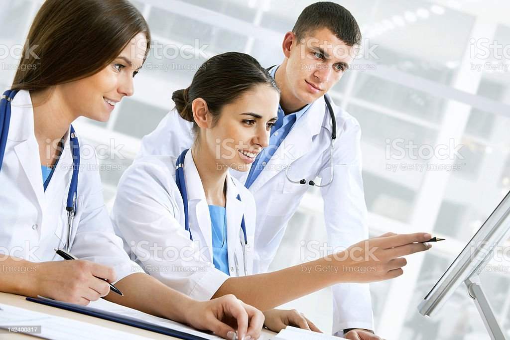 Young doctors looking at a computer screen royalty-free stock photo