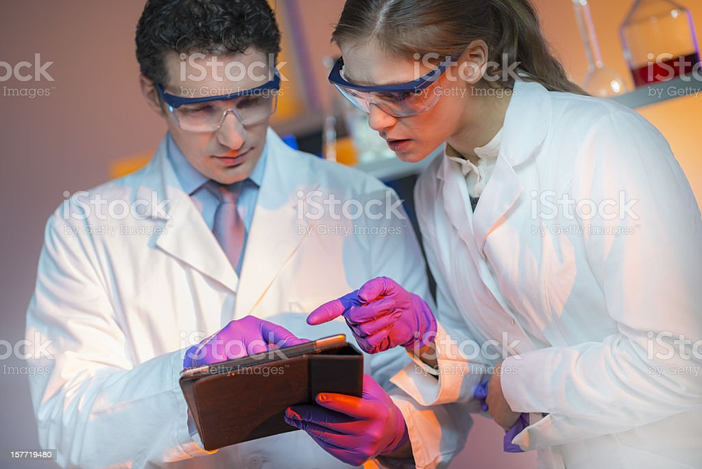 Young Doctors Looking at Digital Tablet royalty-free stock photo
