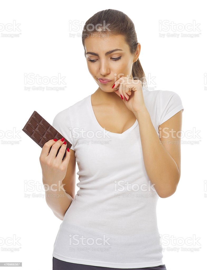 Young doubting girl with chocolate stock photo
