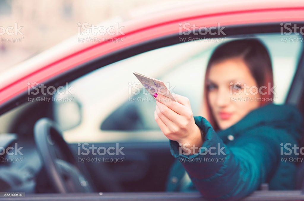 Young driver showing driver's licence stock photo