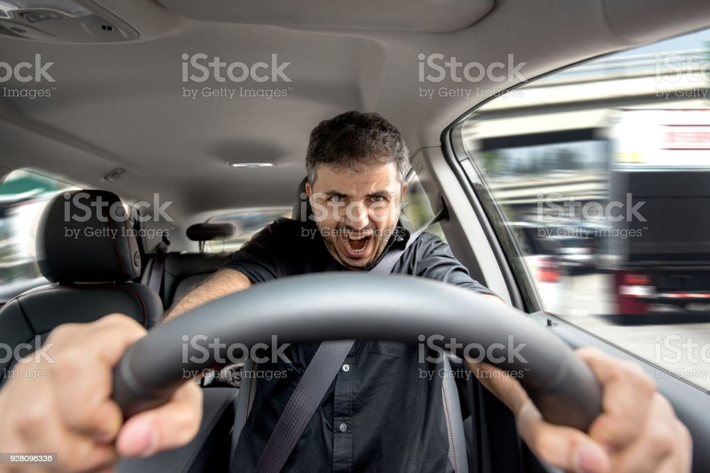 Young driving his vehicle and about getting into an accident stock photo