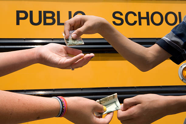 young drug dealers 2 children making a drug exchange.  Please view all these along with all student  images in my portfolio.  drug dealer stock pictures, royalty-free photos & images