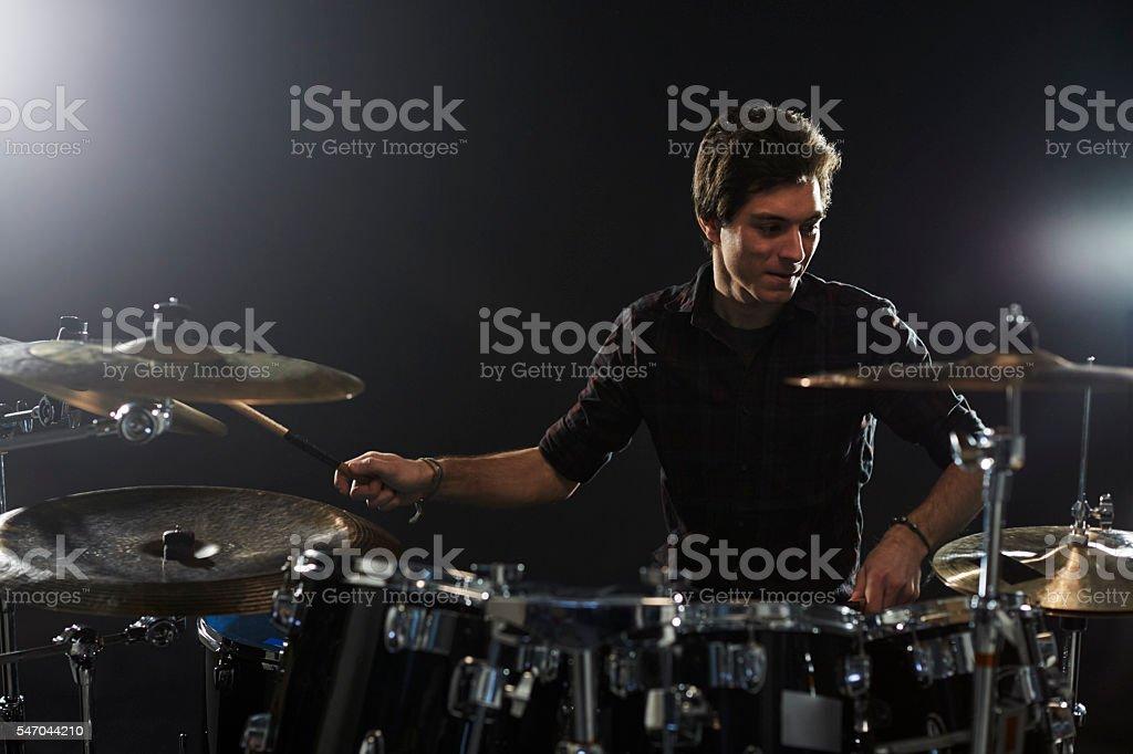 Young Drummer Playing Drum Kit In Studio - foto de acervo