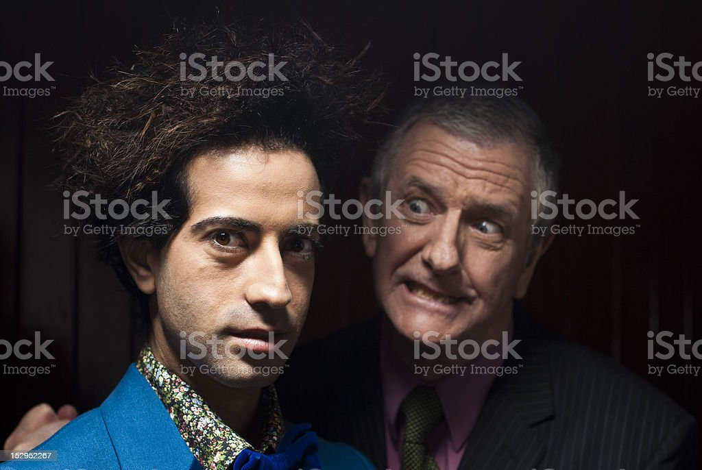 Young dude being yelled at by angry older man royalty-free stock photo