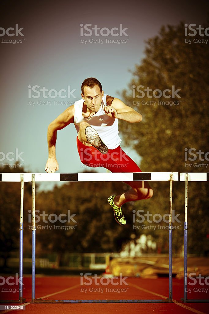 young dynamic hurdler royalty-free stock photo