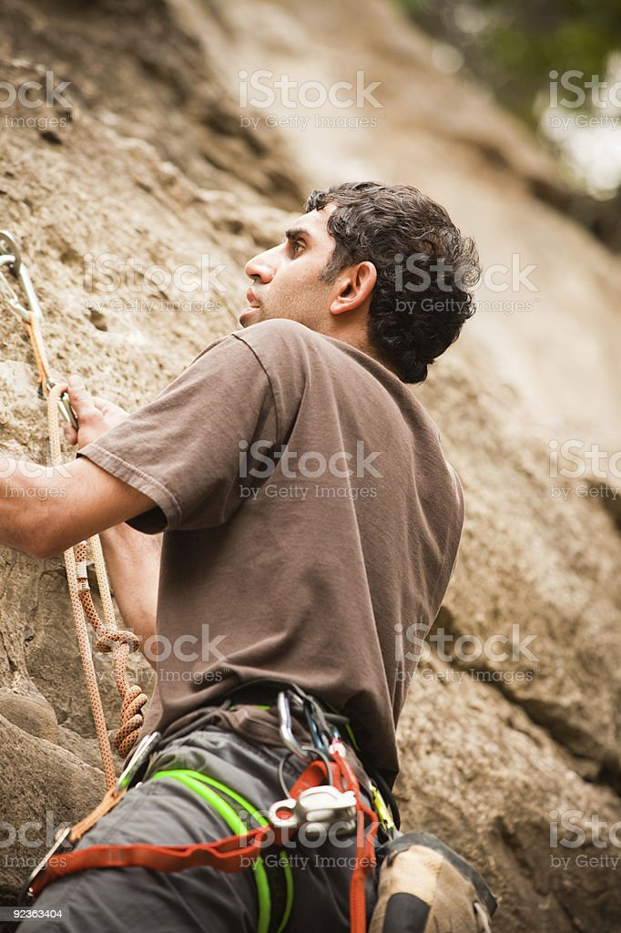Young East Indian Male Rock climbing royalty-free stock photo