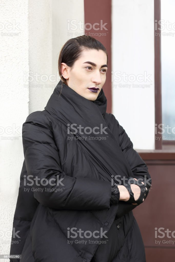 Young eccentric man with bright makeup stock photo