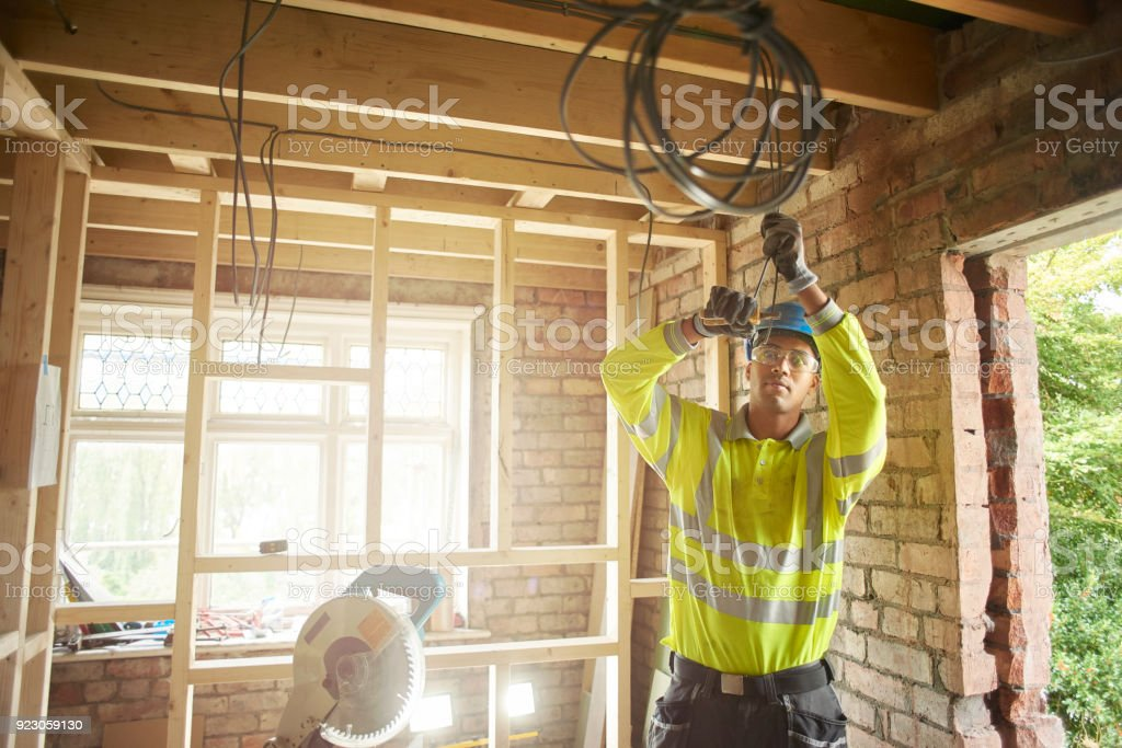 young electrician on site stock photo