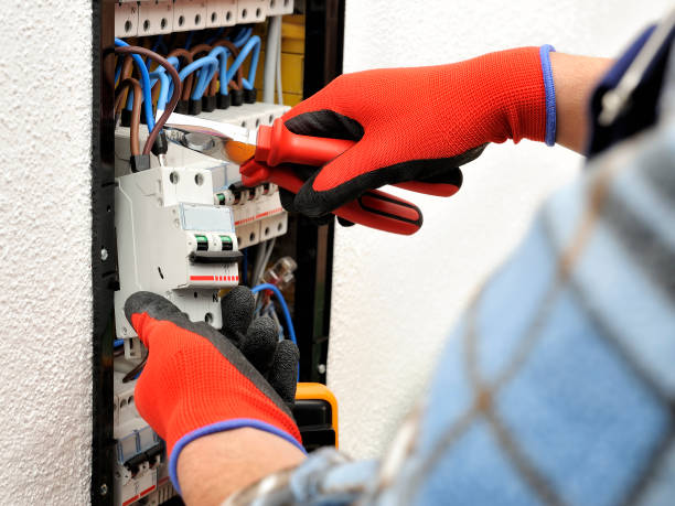 young electrician technician at work on a electrical panel with protective gloves - protective glove stock pictures, royalty-free photos & images