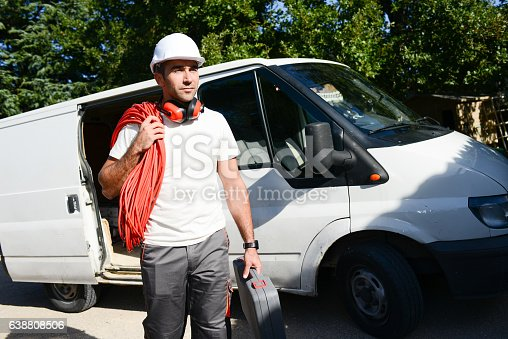 istock young electrician worker taking tools out of professional truck van 638808506