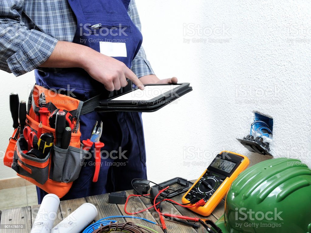 Young Electrician Working In A Residential Electrical Installation ...