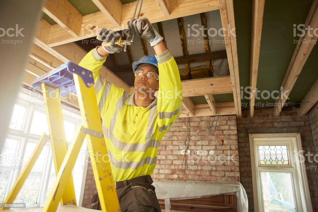 young electrician working on a remodel stock photo