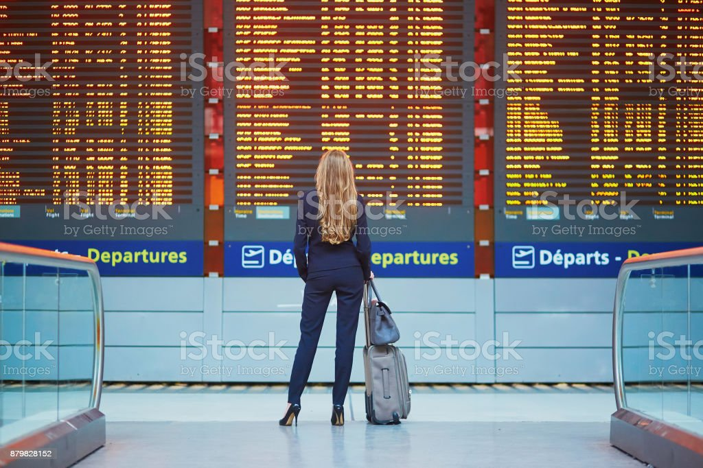 Young elegant business woman in international airport stock photo