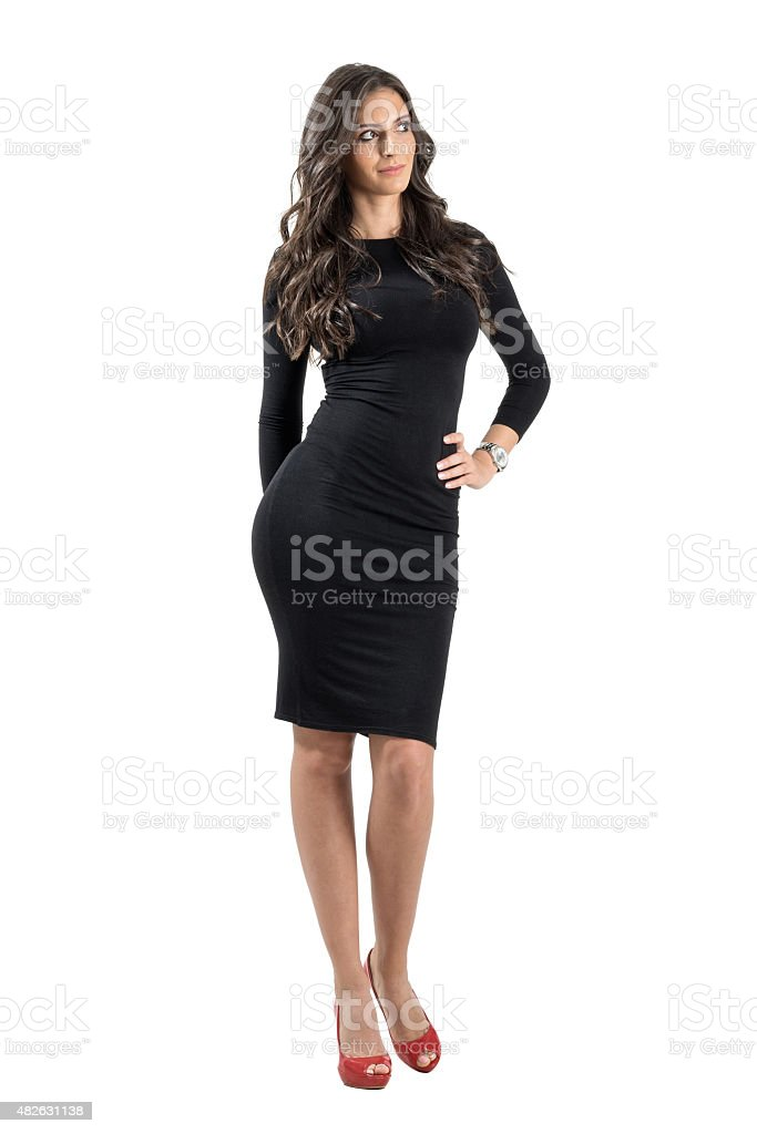 Young elegant lady in black dress looking away stock photo