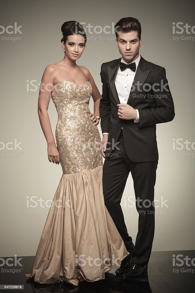 Young elegant man and woman posing stock photo
