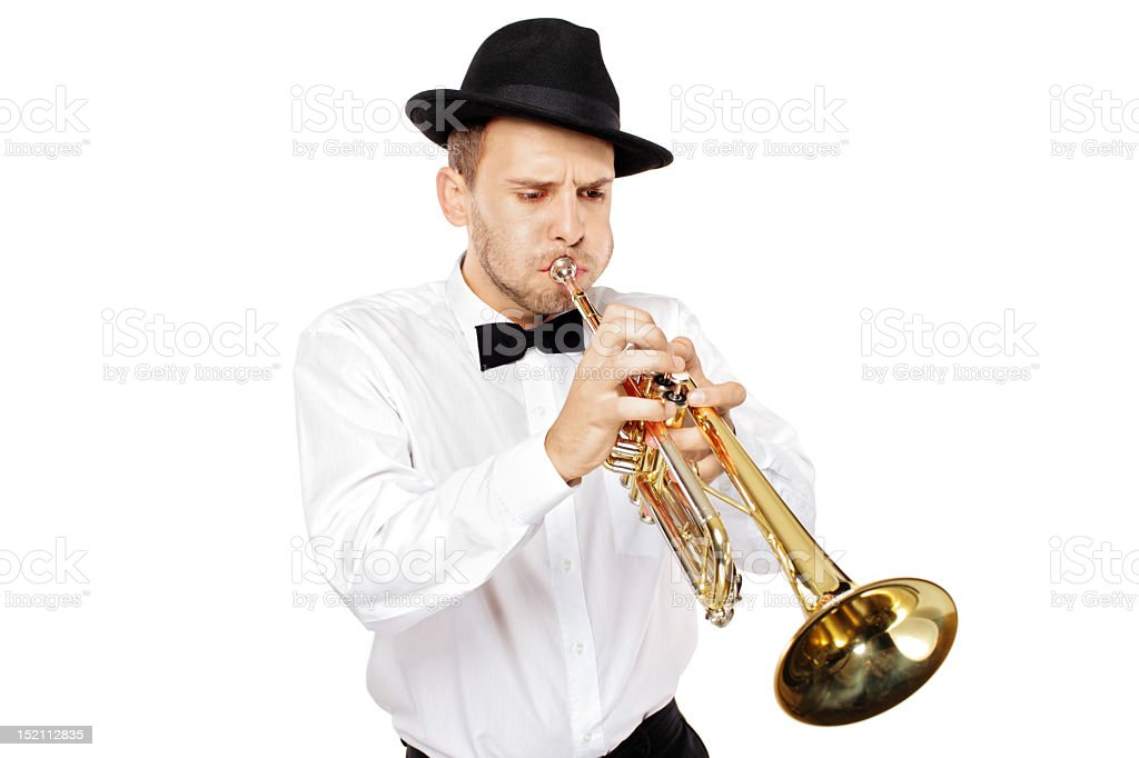Young elegant man with a hat playing the trumpet royalty-free stock photo