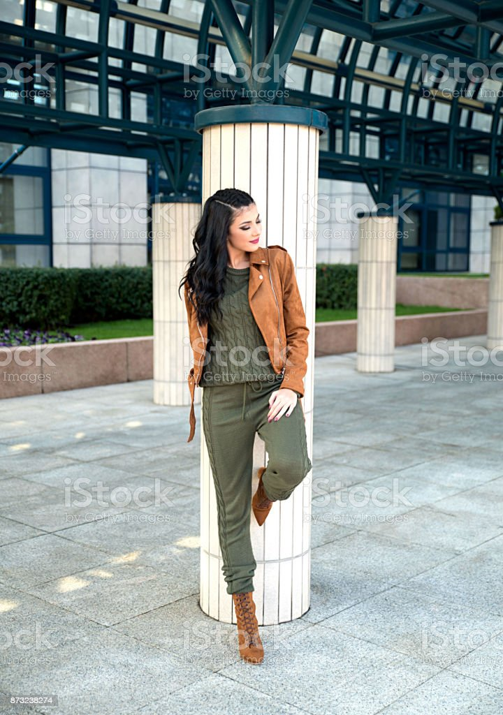 Young elegant woman wearing jumpsuit and jacket stock photo