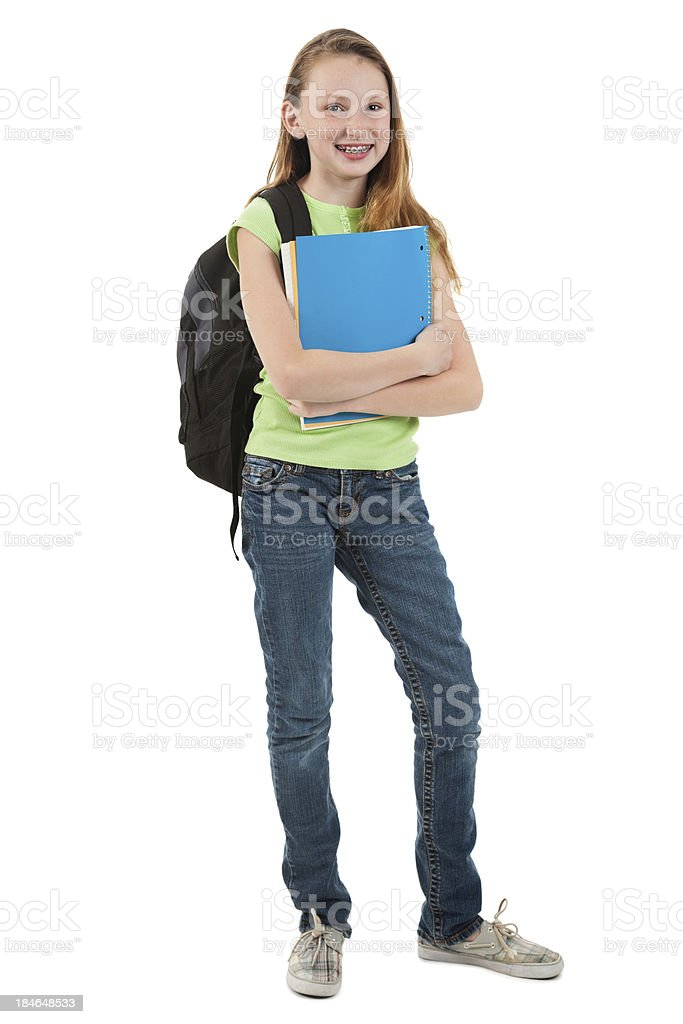 Young elementary school girl carrying supplies and backpack royalty-free stock photo