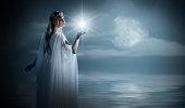 Elven girl with star on sea coast