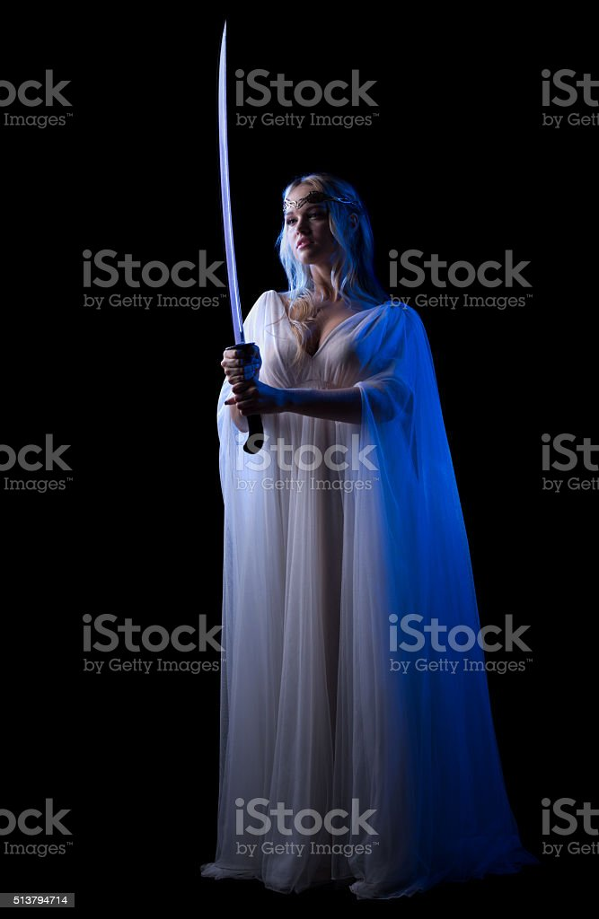 Young elven girl with sword isolated stock photo