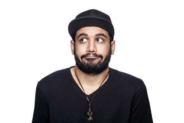 young emotional man with black t-shirt and cap. - geek t shirts stock-fotos und bilder