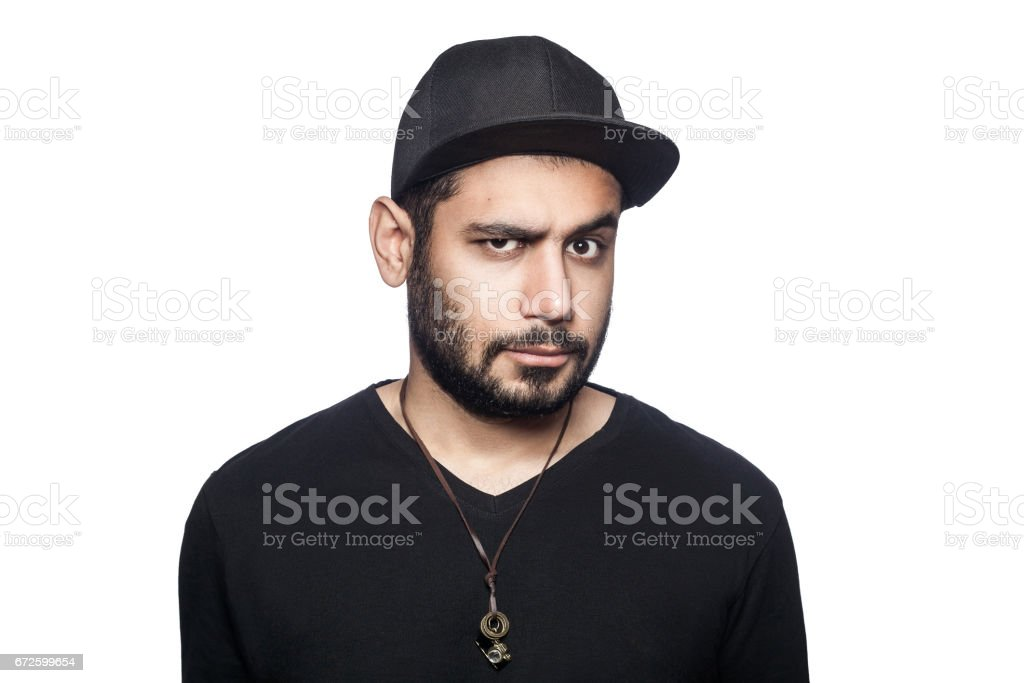 Young emotional man with black t-shirt and cap. stock photo