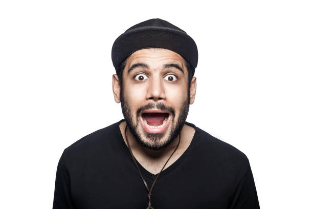 young emotional man with black t-shirt and cap. - excited emoji stock photos and pictures