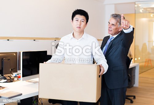 1181817161 istock photo young employee has been fired and is leaving office 482964513
