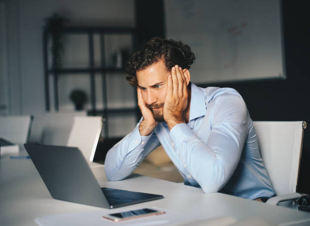 A young employee immersed in his work assignment. stock photo