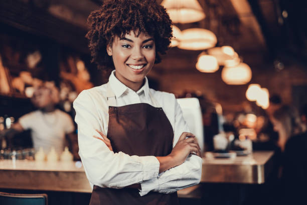 Young employee lady looking at camera and smiling stock photo
