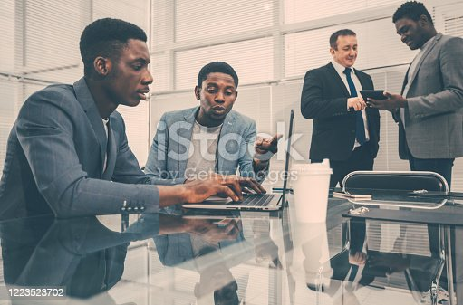 1124783373 istock photo young employees using a laptop in the office 1223523702