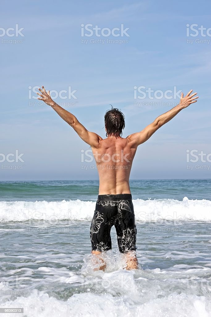 Young energetic man enjoying freedom at the atlantic ocean - Royalty-free Adult Stock Photo