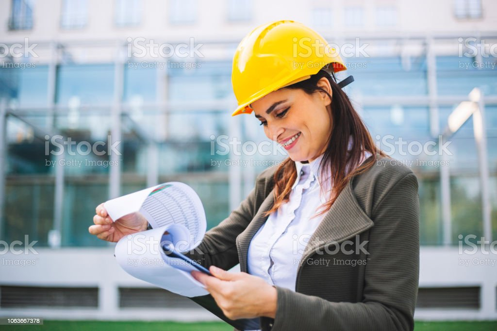 Young engeneer at construction site stock photo